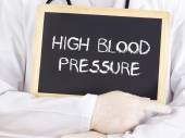 Doctor shows information: high blood pressure — Stockfoto