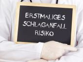 Doctor shows information: first-time stroke risk in german — Stock Photo
