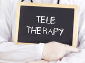 Doctor shows information: teletherapy — Stock Photo