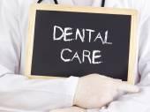 Doctor shows information: dental care — Photo