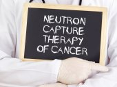 Doctor shows information: neutron capture therapy of cancer — Stock Photo