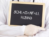 Doctor shows information: stroke risk in german language — Stock Photo