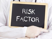 Doctor shows information on blackboard: risk factor — Stock Photo