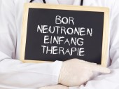 Doctor shows information: boron neutron capture therapy in german — Stock Photo