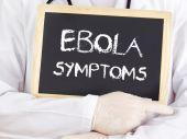 Doctor shows information: Ebola symptoms — 图库照片