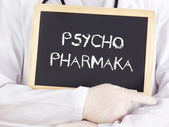 Doctor shows information: psychiatric medication in german — Stock Photo