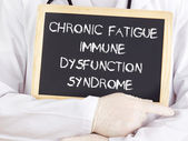Doctor shows information: chronic fatigue syndrome immune dysfunction syndrome — Stock Photo