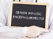 Doctor shows information: benign myalgic encephalomyelitis — Stock Photo