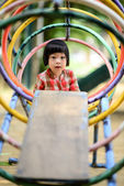 Asian little kid playing in the amusement park — Stock Photo