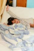 Adorable little girl sleeping in a bed, look at camera. — Stock Photo