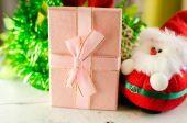 Santa doll gift box and christmas decoration on wooden backgroun — Stock Photo