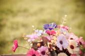 Bear and flower bouquet in brown box on green grass with natural — Stock Photo