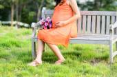 Pregnant woman sitting in the park outdoor. — Stockfoto