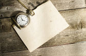 Pocket watch and mulberry paper on wood background with natural  — Stock Photo