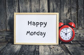 Happy Monday messae on white board and red retro clock  by woode — Stock Photo