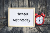 Happy Wednesday message on white board and red retro clock  by w — Stock Photo
