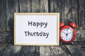 Happy Thursday message on white board and red retro clock  by wo — Stock Photo
