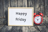 Happy Friday message on white board and red retro clock  by wood — Stock Photo