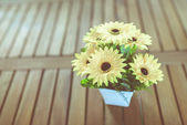 Sunflower vase on wooden table. — Стоковое фото