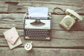 Typewriter coffee and notebook on the wood texture vintage color — Stock Photo