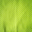 White polka dots on green fabric, vintage style. — Stock Photo #68669407