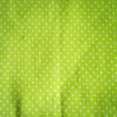 White polka dots on green fabric, vintage style. — Stock Photo