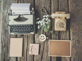 Typewriter coffee and notebook on the wood texture vintage color — Стоковое фото