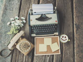 Vintage typewriter and telephone and coffee mug on the wood desk — Stock Photo
