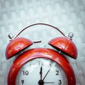 Retro alarm clock on  texture background. — Stock Photo