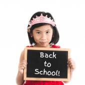 Cute Asian girl in red dress holding Back to school blackboard i — Stock Photo