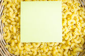 Italian Macaroni Pasta on blank paper note. — Stock Photo