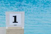 Swimming pool starting block No.1 outdoor. — Stock Photo