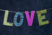 Wooden letters hanging on string — Stock Photo