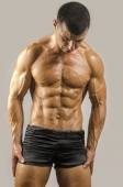 Strong bodybuilder man with perfect abs, shoulders,biceps, triceps and chest — Stock Photo