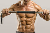 Strong bodybuilder with perfect abs, shoulders,biceps, triceps and chest, personal fitness trainer, flexing his muscles — Stock Photo