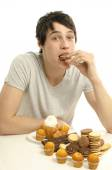 Man in love with sweets, candies,chocolate and sugar — Stock Photo