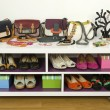 Lots of colorful summer accessories on a shelf. Bags, jewelry, shoes and sandals nicely arranged on a shelf — Stock Photo #64097327