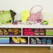 Lots of colorful summer accessories on a shelf. Bags, jewelry, shoes and sandals nicely arranged on a shelf — Stock Photo #64097549
