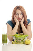 Woman on dieting, eating organic healthy salad, an apple and a fresh smoothie for a perfect body. Green food for a healthy life. Dieting is hard — Stockfoto