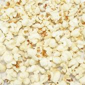 Popcorn on the white background  — Stock Photo