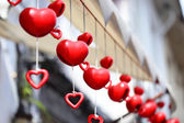 Christmas or Valentine's red heart shaped decoration hanging on  — Foto de Stock
