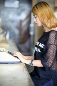 Attractive asian woman using typewriter in the cafe  — ストック写真