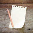 Paper pencil on old wood table — Stock Photo #60499637