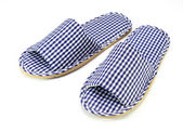 Blue and white home slippers on white background — Stock Photo