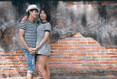 Portrait of attractive asian couple in old town — Stock Photo