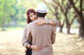 Attractive asian couple in love together in the park — Stock Photo