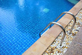 Swimming pool with stair at hotel  — Stockfoto