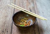 Dirty bowl afer eating on wood table — Stock Photo