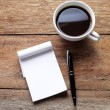 Open a blank white notebook, pen and cup of coffee on wood desk — Stok fotoğraf #83407492