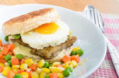 Fish Burger with fried eeg serving boiled mix vegetable — Stock Photo